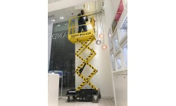 "Micro Scissor Lift 3.2m (10ft 6"") Platform at a Pandora Shop in London"