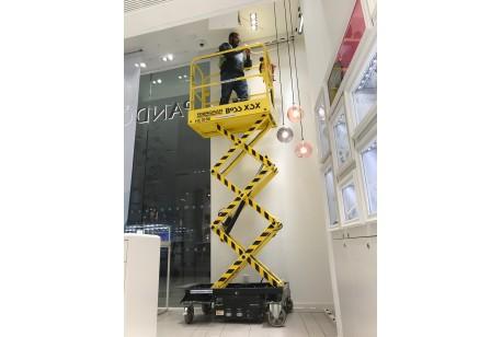 "Micro Scissor Lift 3.2m (10ft 6"") Platform at a Pandora Shop in London"