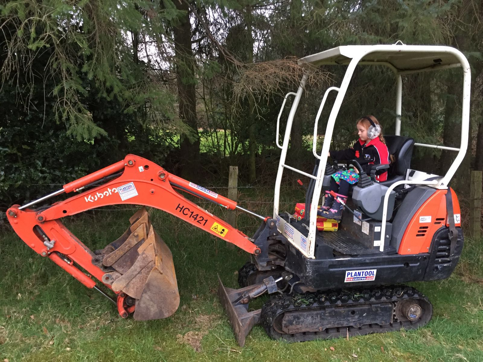 Emily on Plantool's mini excavator
