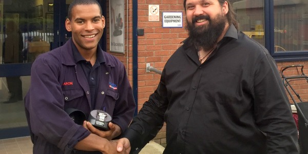 Aaron is rewarded for 10 years service with Plantool